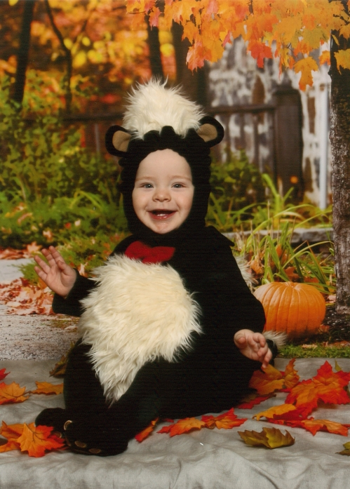 Gabriel in his skunk costume...he was partially so happy because he kept grabbing the leaves and dropping them.